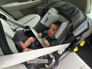 12 pound newborn in Doona installed without base using European belt path
